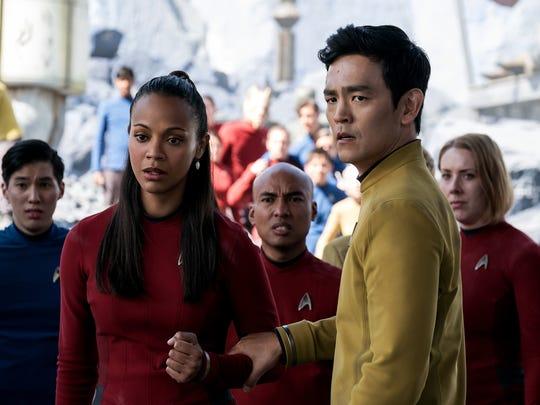 Zoe Saldana (left) plays Uhura and John Cho plays Sulu