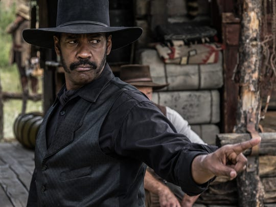 """Denzel Washington stars as bounty hunter Sam Chisolm in the new """"Magnificent Seven."""""""