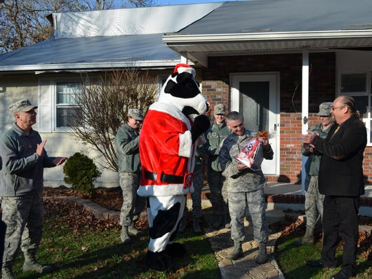 The cow from Chick-Fil-A presented a gift basket to Master Sgt. Christopher LeConey, who won the 9th annual roof giveaway. The contest is organized by East Coast Roofing, Siding & Windows and is completed through partnerships with local businesses.