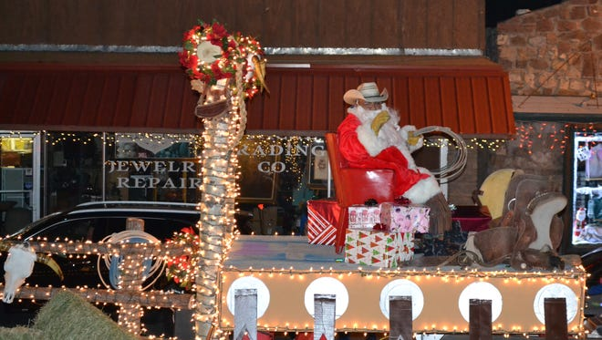 """Even Santa wore his cowboy hat at the Ruidoso Valley Chamber of Commerce's """"Cowboy Christmas"""" themed Festival of Lights parade."""