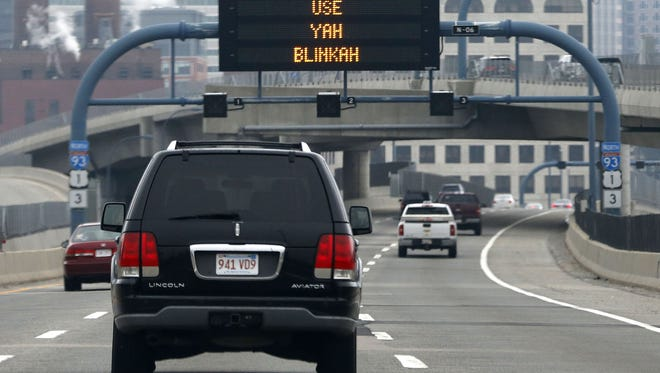 """An electronic highway sign on Interstate 93 in Boston. The writer views this type of message as a distraction.  AP file An electronic highway sign is seen on Interstate 93 in Boston, Friday, May 9, 2014. The Massachusetts Dept. of Transportation posted the message """"Changing Lanes? Use Yah Blinkah"""" on the signs around the city. """"Blinkah"""" is how Bostonians pronounce """"blinker"""". (AP Photo/Michael Dwyer)"""