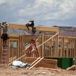 Workers frame a new house in the Little Valley area of St. George on June 30, 2014. More construction jobs have contributed to an improved job market in southwest Utah since the end of the Great Recession.