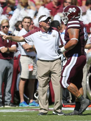 Mississippi State head football coach Dan Mullen talks to Mississippi State's Nick James (88) after James received a personal foul penalty during the Bulldogs' game against Auburn earlier this season.