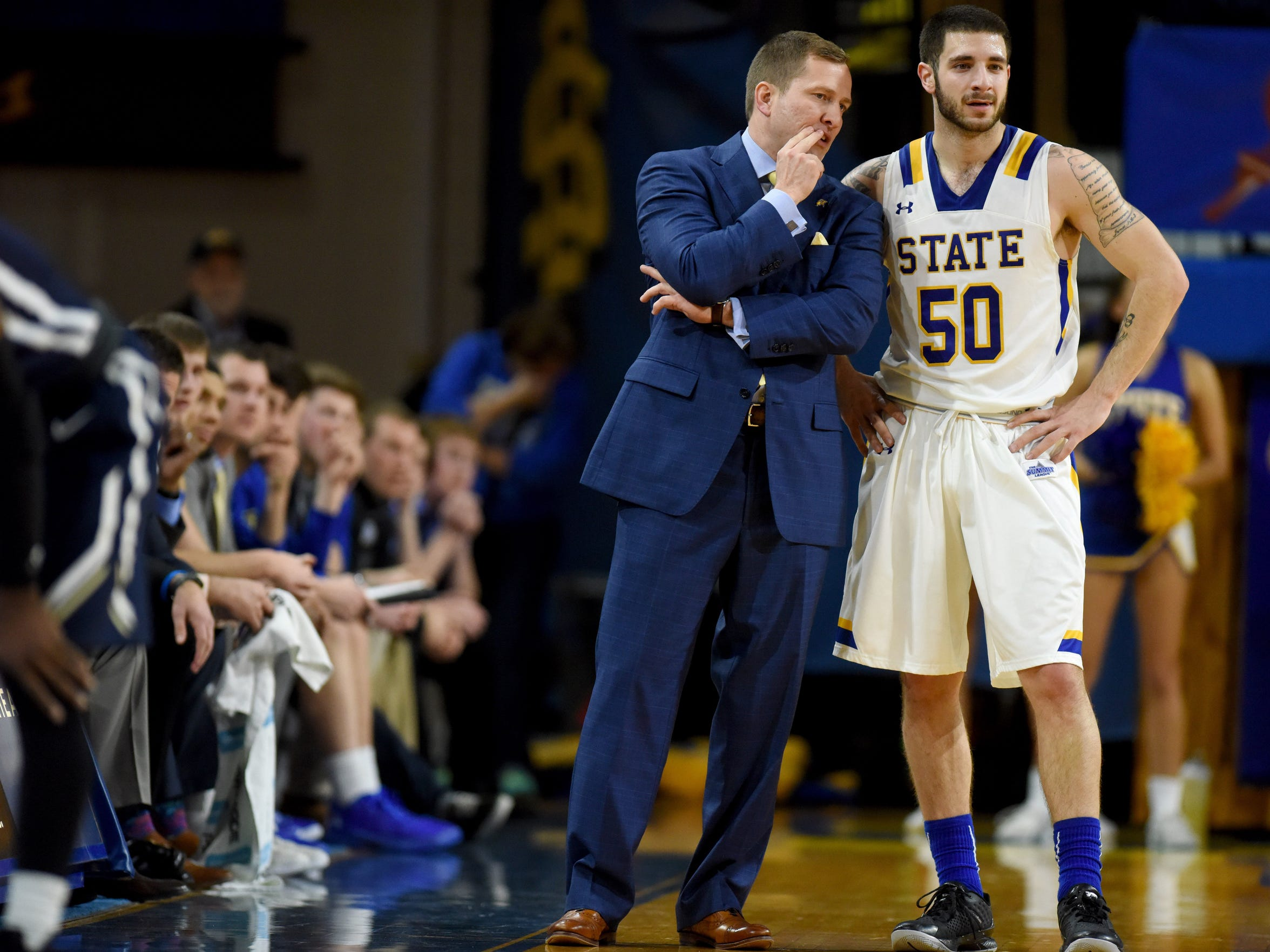 SDSU head men's basketball coach T.J. Otzelberger talks with Michael Orris during their game against Oral Roberts last year at Frost Arena in Brookings.