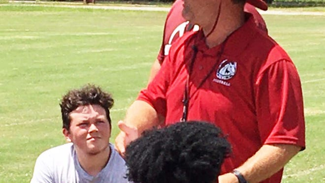 South Effingham football coach Nathan Clark talks to his team after a recent practice.