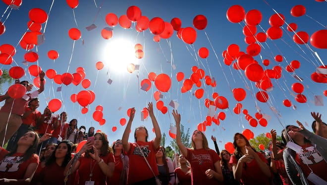 Hanks High School students gathered outside the school Monday to remember their friend Samantha Aguilar, 16, who was killed while riding a ride at the Dia de los Ninos celebration Friday at St. Thomas Aquinas Catholic Church. Hundreds of students gathered and released balloons while listening to Samantha's favorite music.