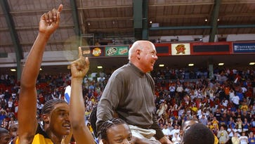 Maron Brown, Valdase Morris and Anthony Robinson carry Wi-Hi coach Butch Waller on their shoulders around Cole Field House after winning the state 2A boys basketball title.