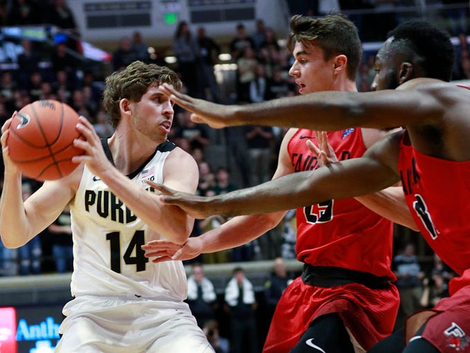 Purdue guard Ryan Cline (14) keeps the basketball away from Fairfield guard Landon Taliaferro and Fairfield forward Jonathan Kasibabu, right, during an NCAA college basketball game, Tuesday, Nov. 6, 2018, in West Lafayette, Ind. Purdue won 90-57. (AP Photo/R Brent Smith)