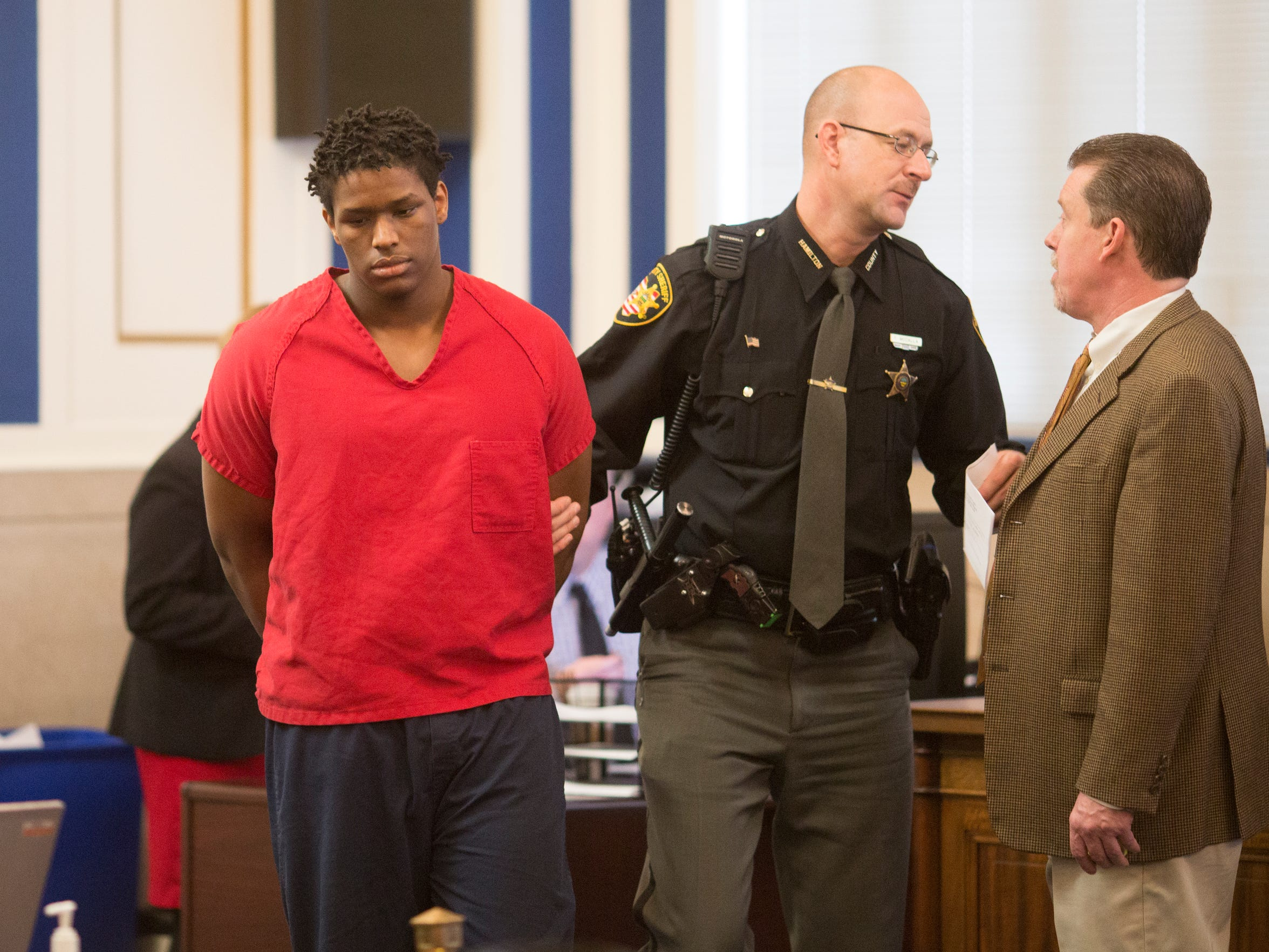 Javon Coulter, 16, enters Judge Megan E. Shanahan's courtroom to take a plea agreement in the shooting death of Suliman Ahmed Abdul-Mutakallim, 39, two years ago.