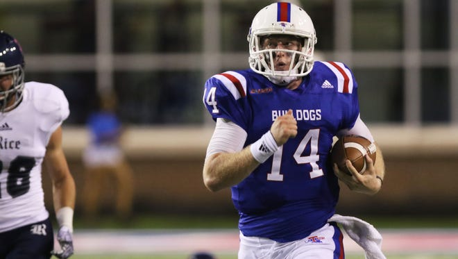Louisiana Tech quarterback Ryan Higgins runs the ball during a home game against Rice University at Joe Aillet Stadium. The Bulldogs travel to North Texas on Saturday.
