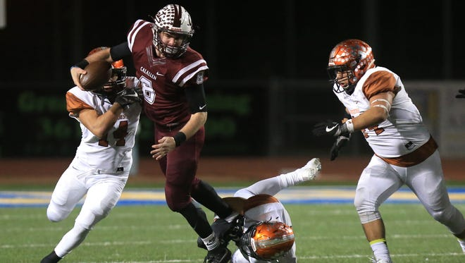 Calallen quarterback Gaige Lamb keeps the ball for a touchdown in the fourth quarter of the game against Mercedes on Friday, November 18, 2016 at Javelina Stadium in Kingsville, TX.