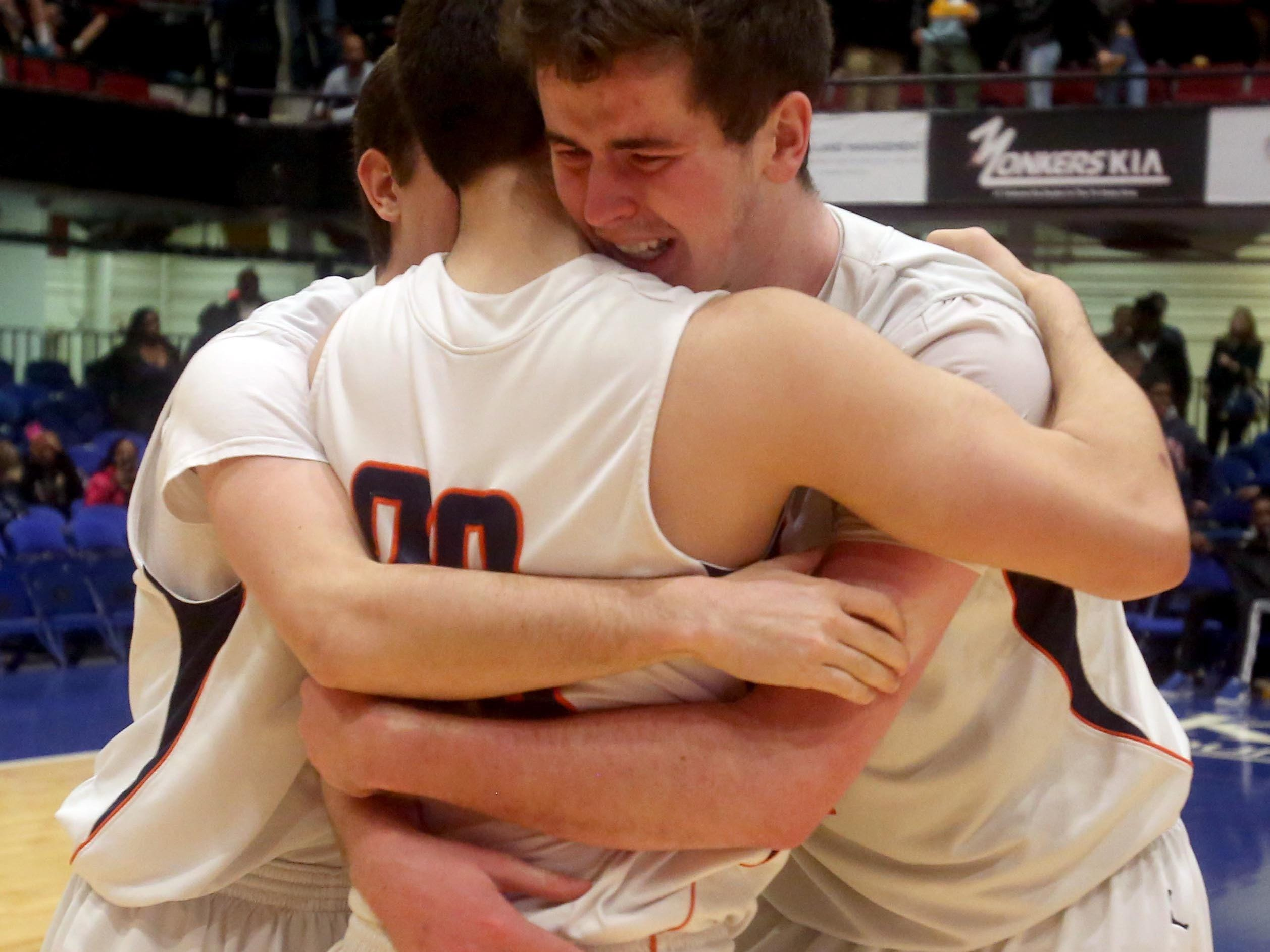 Briarcliff's Sean Crowley, right, celebrates with teammates Joe Canonaco and Nicolas Bennati after Briarcliff defeated Putnam Valley 53-42 to win the Section 1 Class B basketball championship at the Westchester County Center in White Plains Feb. 27, 2016.