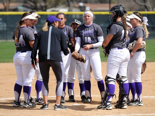 Hardin-Simmons coach Chanin Naudin meets with her team in the circle during the Cowgirls' 10-1, six-inning loss to Mary Hardin-Baylor at Ellis Field on Wednesday, March 21, 2018.