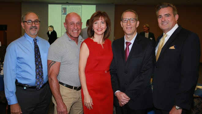 (left to right) Dr. Ken Lichtenstein, Medical Director of HIV Services at Eisenhower Medical Center, Dr. Steven Scheibel, Director of Research at Desert AIDS Project, Event Co-chair Dr. Jeralyn Brossfield, guest speaker Dr. Ran Taube, PhD, and Event Co-chair Patrick Mundt.