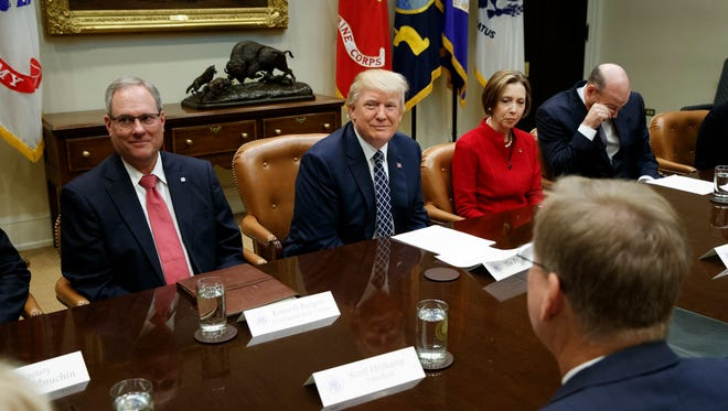 President Donald Trump meets with leaders from small community banks, Thursday, March 9, 2017, in the Roosevelt Room of the White House in Washington. From left are,  FirstCapital Bank of Texas Chairman Kenneth Burgess, Jr.,Trump, Cape Cod Five Cents Savings Bank CEO Dorothy Savarese, National Economic Council Director Gary Cohn.