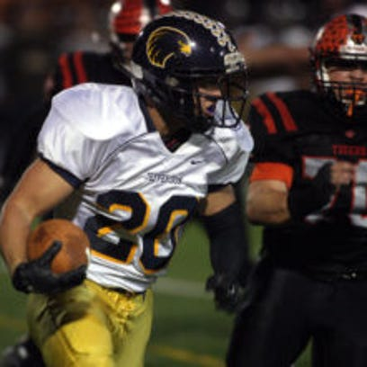 Jefferson running back Connor Brown gains yardage during a game last fall. (Bob Karp/Staff Photographer)