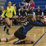 Oshkosh West's Hailey Hendrix (6) reaches for the ball on an Appleton North return in a game played Sept. 10.