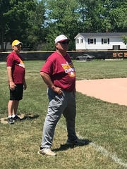 Coach Gandolph watches on as his players participate