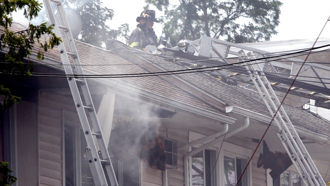 Firefighters vent the roof during a house fire on Farley Dr. in West Haverstraw July 18, 2016.