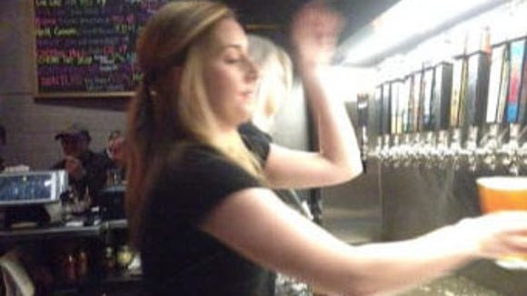 Rosie Reilly pours a Lyin' Eyes beer Thursday at Roak.