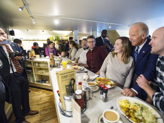 Vice -President Joe Biden poses for a photo as he greets diners at the Penny Cluse Cafe in Burlington before participating in a Cancer Moonshot Roundtable at the University of Vermont on Friday, October 21, 2016.