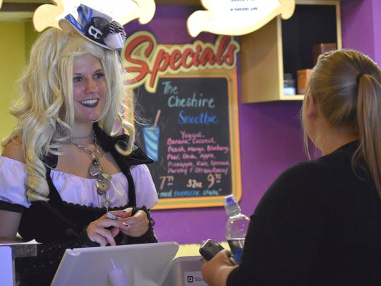 Kristina Gibryic, a Mad Coffee barista, takes a customer's order during the grand opening celebration on Saturday.
