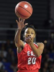 Erica Haynes-Overton (20) passes as East plays Fulton