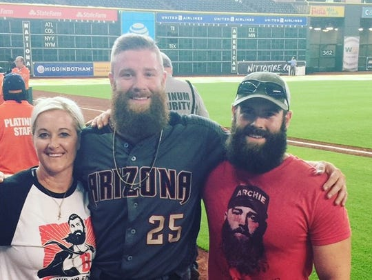 Archie Bradley (center) poses with his sister, Bekie,