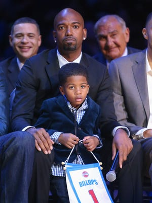 Former Pistons guard Richard Hamilton and his son Parker listen as Chauncey Billups' jersey is retired Feb. 10, 2016 at the Palace.
