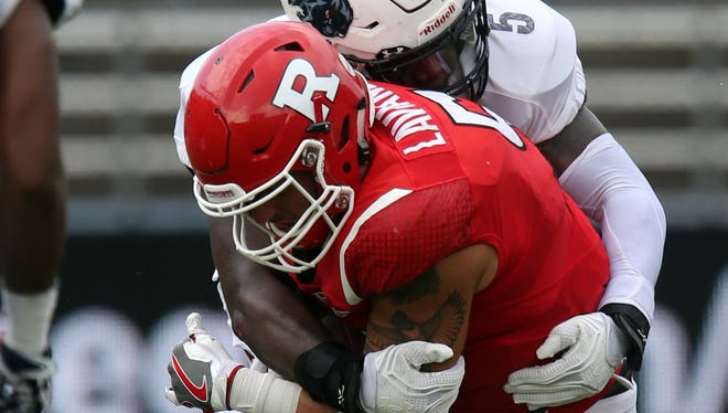 Rutgers quarterback Chris Laviano is sacked by Howard's Devin Rollins on Saturday.