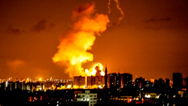 An explosion is seen in Gaza City after an airstrike by Israeli forces on June 18, 2018. Israeli aircraft pounded over a dozen militant targets in Gaza.