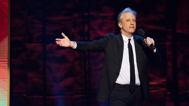 "In this Feb. 28, 2015 photo, Jon Stewart appears onstage at Comedy Central's ""Night of Too Many Stars: America Comes Together for Autism Programs"" at the Beacon Theatre in New York."