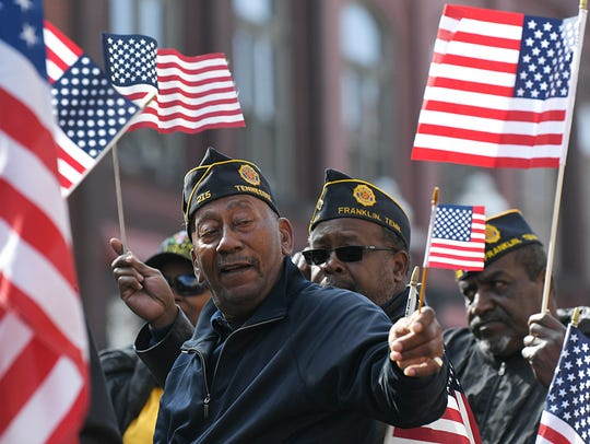 Veterans with the Franklin American Legion Post 215 ride on a float during Franklin Veterans Day Parade in downtown Franklin on November 10, 2017