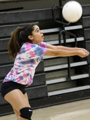 Adrianna Joyner prepares to return a ball during practice at the Tiger Pit on Thursday.
