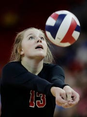 Lourdes Academy's Claire Chier (13) passes against Benton in a Division 4 semifinal at the 2017 WIAA state girls volleyball tournament.