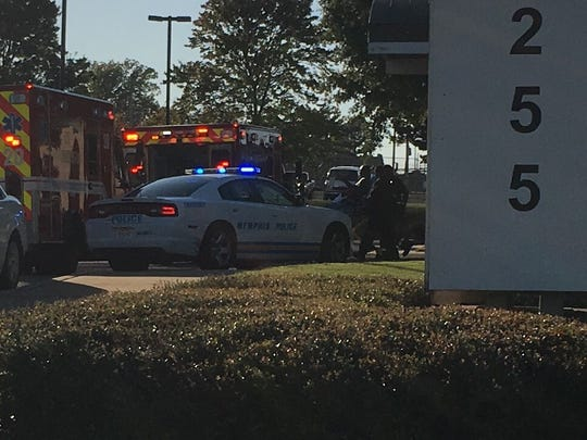 Emergency workers use a gurney to take a person out of Campbell Clinic Surgery Center Midtown on Thursday afternoon. A shooting was reported at the clinic.