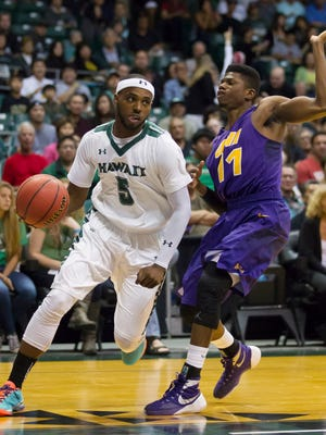 Hawaii guard Roderick Bobbitt (5) drives the baseline while being defended by Northern Iowa guard Wes Washpun (11) in the first half of an NCAA college basketball game at the Diamond Head Classic, Tuesday, Dec. 22, 2015, in Honolulu.