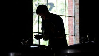 In this Tuesday, June 11, 2012 photo, brewer Ryan Demler cleans a fermenter at the C.H. Evans Brewing Co. at the Albany Pump Station in Albany.