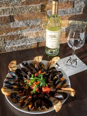 "V&M Bistro's ""Cozze alla Diavola"" mussels, paired with a 2015 Santa Margherita Pinot Grigio at the restaurant on Marsh Road in Brandywine Hundred on Thursday evening."