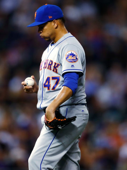 New York Mets relief pitcher Hansel Robles steps back onto the mound to face Colorado Rockies' Nolan Arenado after having given up a walk and a single during the ninth inning of a baseball game Tuesday, Aug. 1, 2017, Denver. The Rockies won 5-4 on a single hit by Arenado. (AP Photo/David Zalubowski)