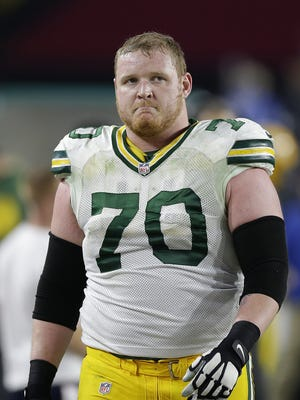 Green Bay Packers guard T.J. Lang (70) shows his disappointment after the Packers turned the ball over on downs late in the fourth quarter during their NFC divisional playoff game at University of Phoenix Stadium.