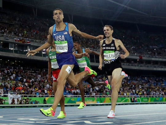 United States' Matthew Centrowitz crosses the line to win gold in the men's 1500-meter final during the athletics competitions of the 2016 Summer Olympics at the Olympic stadium in Rio de Janeiro, Brazil, Aug. 20, 2016.