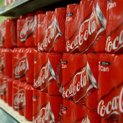 Packaged cans of Coca-Cola Co. soda are displayed for sale at an E-Mart Co. store, a subsidiary of Shinsegae Co., in Incheon, South Korea, on Saturday, Dec. 21, 2013. Consumer prices climbed 0.9 percent in November from a year earlier after a 0.7 percent increase in October that was the smallest gain since July 1999. Photographer: SeongJoon Cho/Bloomberg  ORG XMIT: 459737759
