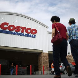 Customers walk toward a Costco Wholesale Corp. store in Nashville, Tennessee, U.S., on Friday, Sept. 25, 2015.