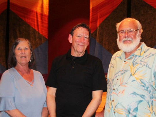 Gifford Youth Achievement Center Director of Philanthropy Peggy Gibbs, left, storyteller Doug Berky and George Blythe.