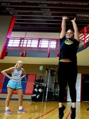 Hailey Decker, 21, of Eugene tests her jump height as Reina Strand, 17, of Keizer looks on during a performance training class at Courthouse Fitness in Salem.