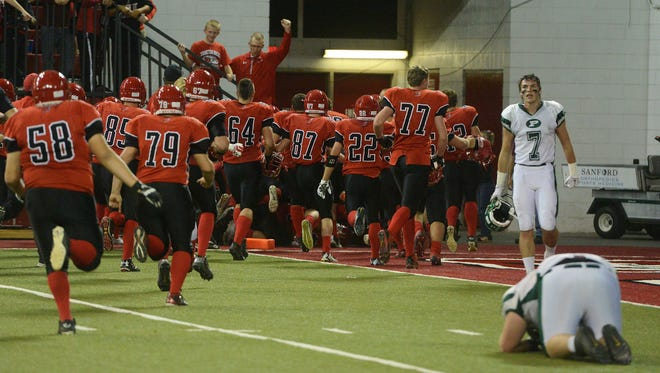 The Yankton Bucks celebrate their 21-20 overtime win over Pierre in Friday's class 11AA football championship at the DakotaDome in Vermillion, Nov 13, 2015.