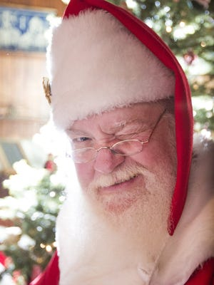 Santa gets around, especially on Christmas night. This is a local Santa, Brian Campbell of Redford, giving a wink.