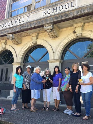 Former classmates, from left, Arlene Iavarone, Carol Freitas Trimper, Phyllis Pope, Denise Honard LaBorde, Evelyn Phillips Smith, Kitty Perseo Nick, Karen Leone Reynolds and Dina Tavinello Miller pose on the steps of Roosevelt Middle School, which is soon to be demolished.