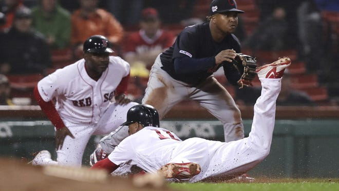 Carlos Febles, shown previously, was back as Red Sox third-base coach on Friday.